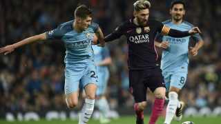 Manchester City's English defender John Stones (L) vies with Barcelona's Argentinian striker Lionel Messi (C) during the UEFA Champions League group C football match between Manchester City and Barcelona at the Etihad Stadium in Manchester, north west England on November 1, 2016. / AFP PHOTO / OLI SCARFF