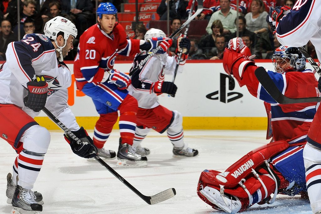 MONTREAL, QC - NOVEMBER 24: Carey Price #31 of the Montreal Canadiens makes a glove save in front of Derek MacKenzie #24 of the Colombus Blue Jackets on November 24, 2009 at the Bell Centre in Montreal, Quebec, Canada. (Photo by Francois Lacasse/NHLI via Getty Images)