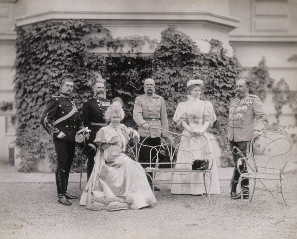 L-R: Crown Prince Ferdinand of Romania, King Carol I of Romania, Queen Elisabeth of Romania (seated), Emperor Franz Josef of Austria, Crown Princess Marie of Romania, and Prince Alfred of Great Britain and Duke of Coburg. (Photo by © Alinari Archives/CORBIS/Corbis via Getty Images)