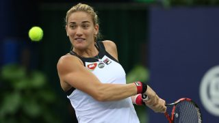 ZHUHAI, CHINA - NOVEMBER 02:  Timea Babos of Hungary returns a shot during the women's singles round robin against Timea Bacsinszky of Switzerland on Day two of the 2016 WTA Elite Trophy Zhuhai at Zhuhai Hengqin International Tennis Centre on November 2, 2016 in Zhuhai, Guangdong Province of China.  (Photo by VCG/VCG via Getty Images)