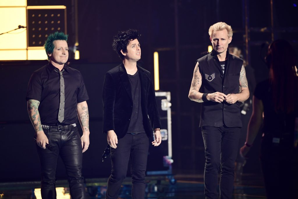 ROTTERDAM, NETHERLANDS - NOVEMBER 06:  Idris Elba (not pictured) presents the Global Icon award to Tre Cool, Billie Joe Armstrong and Mike Dirnt of Green Day on stage at the MTV Europe Music Awards 2016 on November 6, 2016 in Rotterdam, Netherlands.  (Photo by Ian Gavan/Getty Images for MTV)
