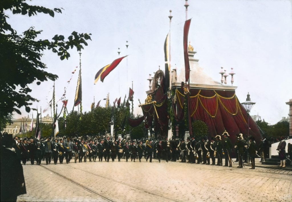 AUSTRIA - MAY 21:  Festive procession in honor to Emperior Franz Josef I. to celebrate his 60th crown jubilee. Children honoring the Emperor. Vienna. Hand-colored lantern slide. 21. 5. 1908.  (Photo by Oesterreichsches Volkshochschularchiv/Imagno/Getty Images)