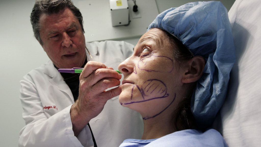 UNITED STATES - SEPTEMBER 11:  Dr. Richard Ellenbogen prepares for a stem cell facelift procedure on patient on Sema Atavi at Beverly Hills Body Cosmetic Surgery Specialists in Los Angeles, California, U.S., on Friday, Sept. 11, 2009. Allergan Inc.'s wrinkle-smoother Botox may also help migraine patients have fewer painful headaches, according to two studies at a research conference.  (Photo by Jonathan Alcorn/Bloomberg via Getty Images)