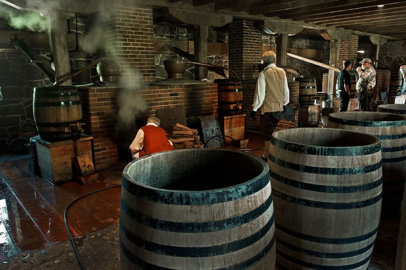 Volunteers work the wood fired still boilers to produce  barley-based single malt whiskey at George Washingon's original distillery, March 25, 2012 in Mount Vernon, Virginia.  Master distillers from Scotland are stepping three centuries back in time to make single malt whiskey in the same place where George Washington produced his own liquid gold.    AFP PHOTO / PAUL J. RICHARDS / AFP PHOTO / PAUL J. RICHARDS