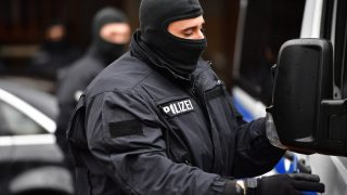 """HILDESHEIM, GERMANY - NOVEMBER 08: Heavily-armed police stand outside at the Deutschsprachiger Islamkreis e.V. mosque where hours earlier they arrested  Ahmad Abdulaziz Abdullah A., alias """"Abu Walaa"""", a 32-year-old imam from Iraq, on November 8, 2016 in Hildesheim, Germany. Police announced they arrested five men today in Lower Saxony and North Rhine-Westphalia on charges of recruiting fighters for the Islamic State (IS). (Photo by Alexander Koerner/Getty Images)"""