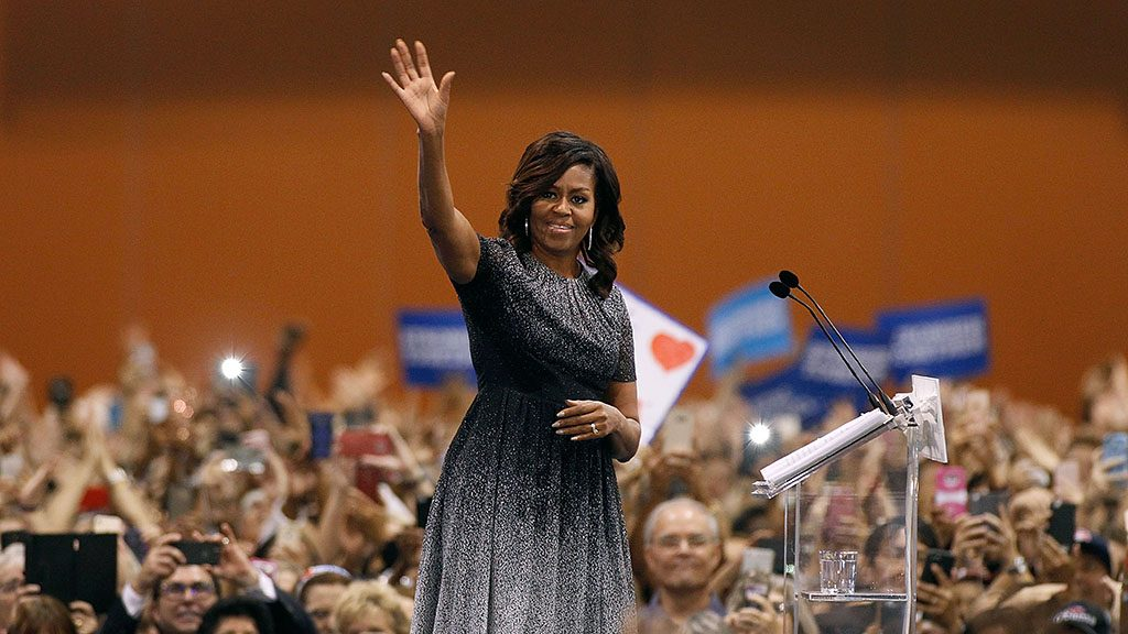 PHOENIX, AZ - OCTOBER 20:  First Lady Michelle Obama waves to the crowd as she speaks at an Arizona Democratic Party Early Vote rally in support of Democratic presidential nominee Hillary Clinton and vice presidential nominee Tim Kaine on October 20, 2016 in Phoenix, Arizona.  (Photo by Ralph Freso/Getty Images)