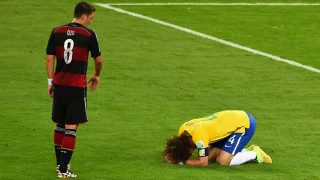 BELO HORIZONTE, BRAZIL - JULY 08:  David Luiz of Brazil reacts after being defeated 7-1 by Germany as Mesut Oezil of Germany looks on during the 2014 FIFA World Cup Brazil Semi Final match between Brazil and Germany at Estadio Mineirao on July 8, 2014 in Belo Horizonte, Brazil.  (Photo by Jamie McDonald/Getty Images)