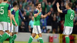 Northern Ireland's Will Grigg (C) celebrates with teammates after scoring the team's third goal against Belarus during an international friendly football match between Northern Ireland and Belarus at Windsor Park in Belfast, Northern Ireland, on May 27, 2016. / AFP PHOTO / PAUL FAITH