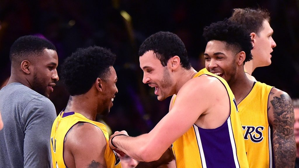 LOS ANGELES, CA - NOVEMBER 22: Nick Young #0 of the Los Angeles Lakers celebrates a 111-109 win over the Oklahoma City Thunder with Larry Nance Jr. #7, Brandon Ingram #14 and Tarik Black #28 at Staples Center on November 22, 2016 in Los Angeles, California. NOTE TO USER: User expressly acknowledges and agrees that, by downloading and or using this photograph, User is consenting to the terms and conditions of the Getty Images License Agreement.   Harry How/Getty Images/AFP