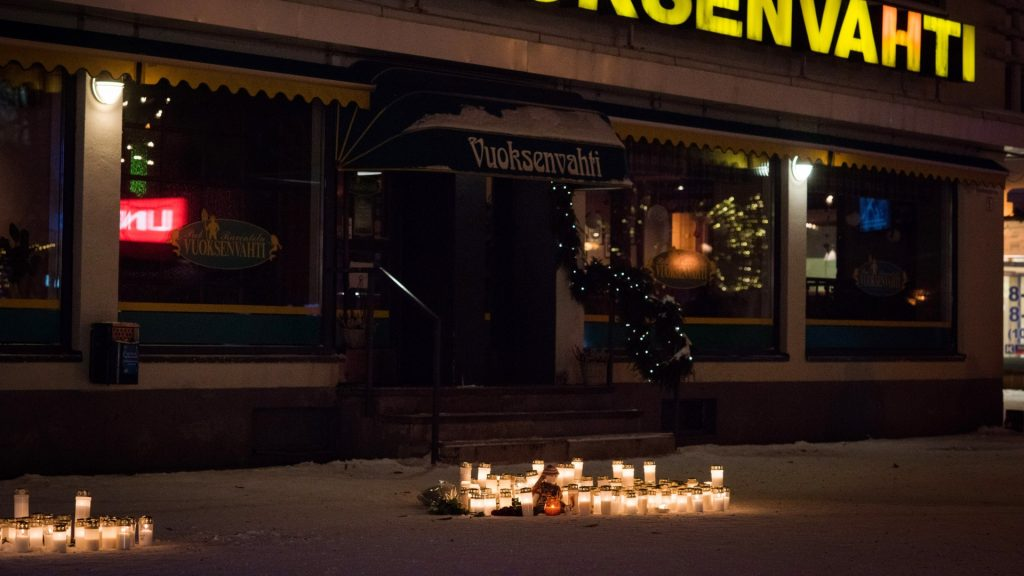 Candles and a doll have been left at a makeshift memorial in front of the restaurant Vuoksenvahti, in Imatra, Eastern Finland, where three women were killed on December 4, 2016. A gunman shot dead three women, including a local council official, as they were leaving a restaurant in a small Finnish town on Saturday night, police said. / AFP PHOTO / Lehtikuva / Hannu Rissanen / Finland OUT