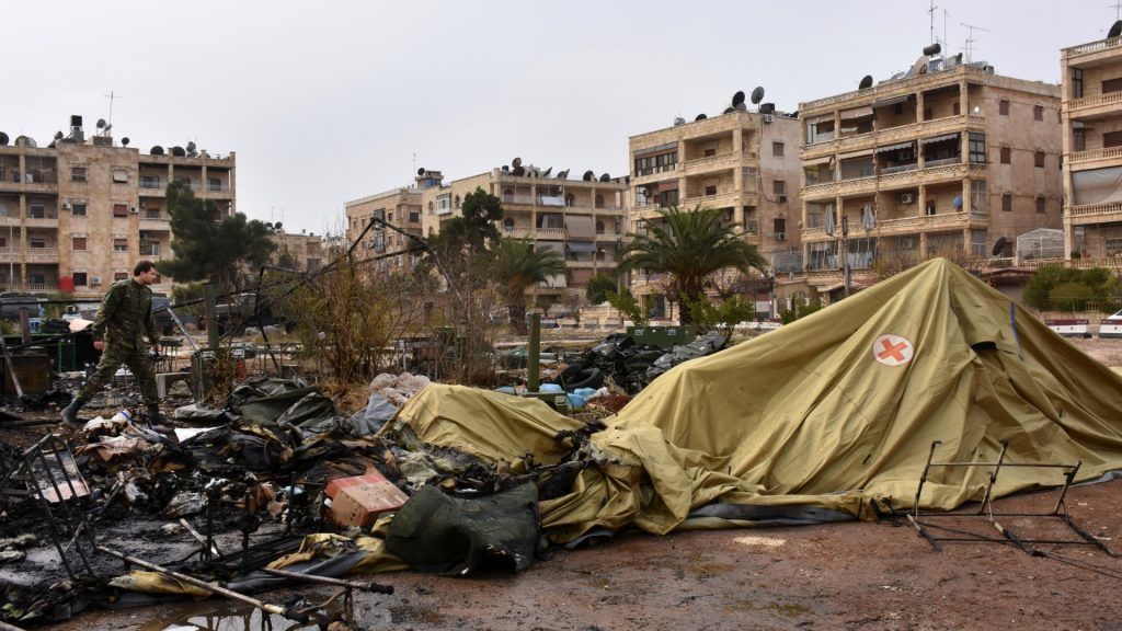 A Russian soldier inspects the damage at a field hospital that was reportedly destroyed by rebel shelling on December 5, 2016 in the Furqan neighbourhood of the government-held side of west Aleppo. A Russian army medic was killed Monday and two others seriously injured in rebel shelling of a field hospital in Syria's Aleppo, Russia's defence ministry said, blaming Western nations who support rebel fighters. / AFP PHOTO / GEORGE OURFALIAN