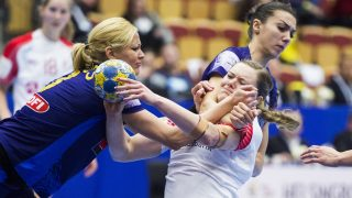 Denmark's Anne Mette Hansen (R) vies with Romania's Cristina Zamfir during the Women's European Handball Championship group 2 main round match between Denmark and Romania in Helsingborg, Sweden, on December 14, 2016.  / AFP PHOTO / TT News Agency / Emil LANGVAD / Sweden OUT