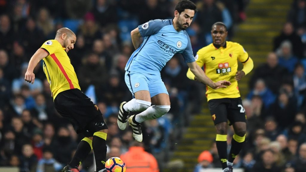 Watford's Dutch-born Moroccan midfielder Nordin Amrabat (L) tackles Manchester City's German midfielder Ilkay Gundogan (C) during the English Premier League football match between Manchester City and Watford at the Etihad Stadium in Manchester, north west England, on December 14, 2016. / AFP PHOTO / Anthony DEVLIN / RESTRICTED TO EDITORIAL USE. No use with unauthorized audio, video, data, fixture lists, club/league logos or 'live' services. Online in-match use limited to 75 images, no video emulation. No use in betting, games or single club/league/player publications.  /