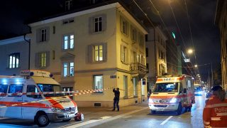 Ambulance and police cars are seen outside a Muslim prayer hall, central Zurich, on December 19, 2016, after three people were injured by gunfire.   Local media reported the incident occurred in the Muslim prayer hall near the city's railway station. Swiss media said the three wounded people, all adults, were found in the street where the prayer hall is located. The suspected assailant had fled the scene and police sealed off the area.    / AFP PHOTO / Michael Buholzer
