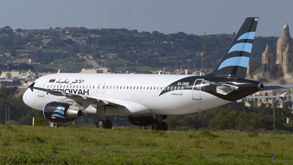 A picture taken on December 23, 2016 shows a hijacked Airbus A320 operated by Afriqiyah Airways after it landed at Luqa Airport, in Malta.