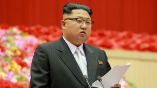 """This photo taken on December 23, 2016 and released on December 24 by North Korea's official Korean Central News Agency (KCNA) shows North Korean leader Kim Jong-Un making an opening address at the First Conference of Chairpersons of the Primary Committees of the Workers' Party of Korea at the Pyongyang Indoor Stadium in Pyongyang. / AFP PHOTO / KCNA / STR / South Korea OUT / REPUBLIC OF KOREA OUT   ---EDITORS NOTE--- RESTRICTED TO EDITORIAL USE - MANDATORY CREDIT """"AFP PHOTO/KCNA VIA KNS"""" - NO MARKETING NO ADVERTISING CAMPAIGNS - DISTRIBUTED AS A SERVICE TO CLIENTS THIS PICTURE WAS MADE AVAILABLE BY A THIRD PARTY. AFP CAN NOT INDEPENDENTLY VERIFY THE AUTHENTICITY, LOCATION, DATE AND CONTENT OF THIS IMAGE. THIS PHOTO IS DISTRIBUTED EXACTLY AS RECEIVED BY AFP.  /"""