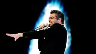 """(FILES) This file photo taken on June 26, 2007 shows British singer George Michael performing during a concert in Amsterdam.British pop star George Michael, who rose to fame with the band Wham! and sold more than 100 million albums in his career, has died aged 53, his publicist said on December 25, 2016. """"It is with great sadness that we can confirm our beloved son, brother and friend George passed away peacefully at home over the Christmas period,"""" the publicist said in a statement. / AFP PHOTO / ANP / EVERT ELZINGA"""