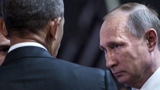 (FILES) This file photo taken on November 20, 2016 shows US President Barack Obama (L) and Russia's President Vladimir Putin talking before an economic leaders meeting at the Asia-Pacific Economic Cooperation Summit at the Lima Convention Centre in Lima.Russia on December 30, 2016 eyed retaliatory measures against the US after President Barack Obama kicked out dozens of suspected intelligence agents and imposed sanctions in a furious dispute over alleged election interference. The barrage of punishment against Moscow over cyberattacks dragged ties between Russia and the United States -- already at their worst since the Cold War -- to a fresh low less than a month ahead of President-elect Donald Trump taking charge. / AFP PHOTO / Brendan Smialowski