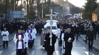 Mourners attend the funeral of Lukasz Urban, the Polish truck driver who was killed in the Berlin Christmas market attack, in Banie near Sczczecin, Poland, on December 30, 2016. Lukasz Urban was shot dead probably by suspected jihadist killer Anis Amri shortly before the market attack, in which 11 other people were killed and almost 50 injured when the truck tore through the crowd, smashing wooden stalls and crushing victims, in scenes reminiscent of July's deadly attack in the French Riviera city of Nice. / AFP PHOTO / Odd ANDERSEN