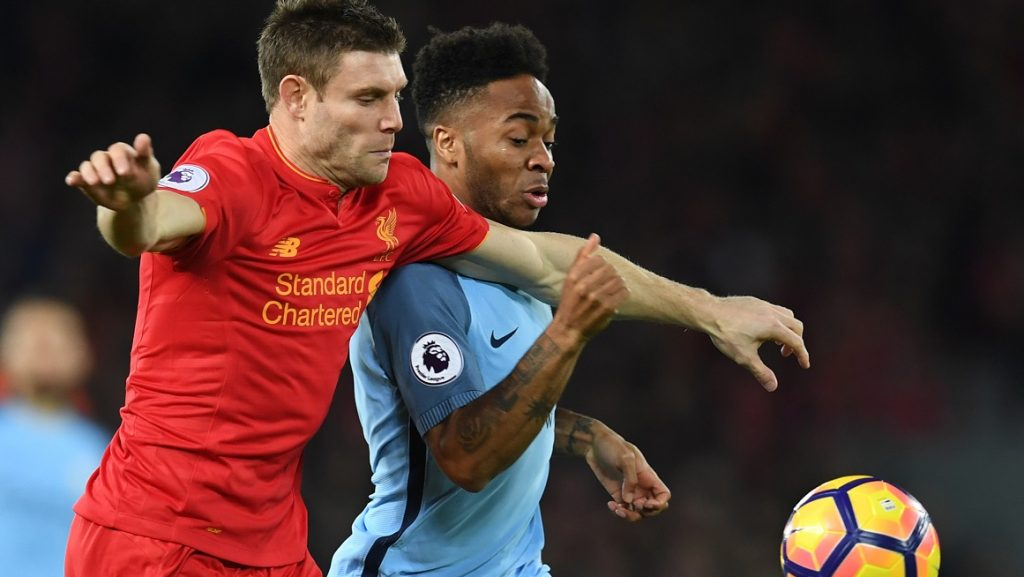 Manchester City's English midfielder Raheem Sterling (R) vies with Liverpool's English midfielder James Milner during the English Premier League football match between Liverpool and Manchester City at Anfield in Liverpool, north west England on December 31, 2016. / AFP PHOTO / Paul ELLIS / RESTRICTED TO EDITORIAL USE. No use with unauthorized audio, video, data, fixture lists, club/league logos or 'live' services. Online in-match use limited to 75 images, no video emulation. No use in betting, games or single club/league/player publications.  /
