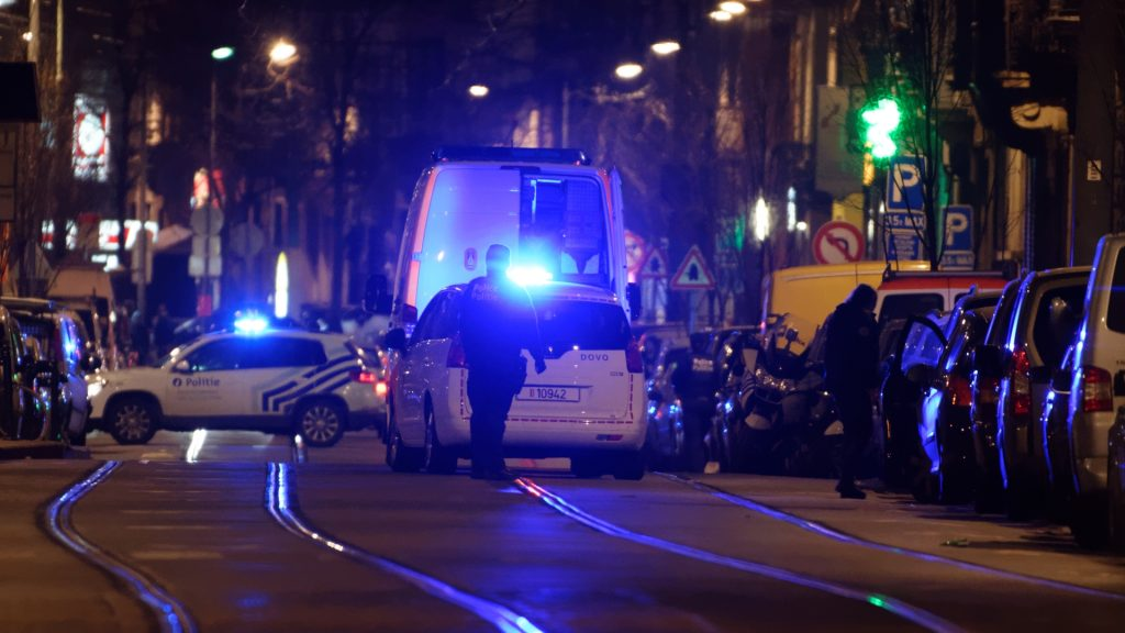 BELGIUM, Schaerbeek: Police cars are parked on the street as Brussels police lock down the Schaerbeek area of Brussels, Belgium for a period of time on the evening of December 19, 2016 to carry out a security operation.One person was arrested during the search. - Olivier Gouallec