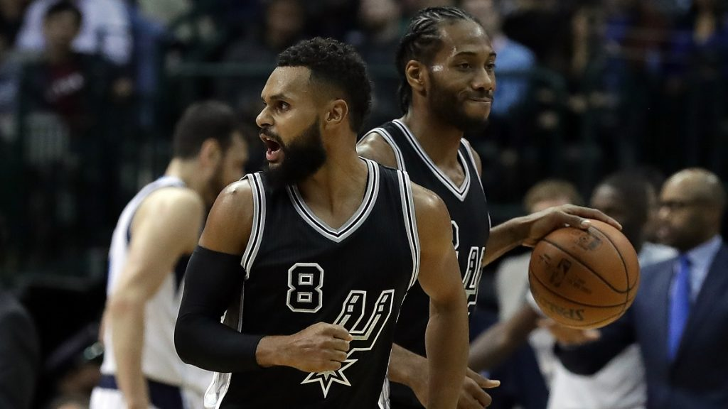 DALLAS, TX - NOVEMBER 30: Patty Mills #8 of the San Antonio Spurs reacts during the second half of play against the Dallas Mavericks at American Airlines Center on November 30, 2016 in Dallas, Texas. NOTE TO USER: User expressly acknowledges and agrees that , by downloading and or using this photograph, User is consenting to the terms and conditions of the Getty Images License Agreement.   Ronald Martinez/Getty Images/AFP