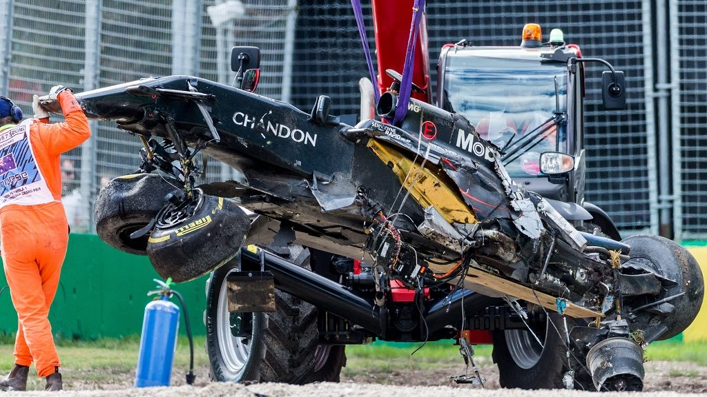 MELBOURNE, AUSTRALIA - MARCH 20 : The destroyed car of Fernando Alonso (SPA) of McLaren-Honda after his serious crash gets craned away during the qualifying of the 2016 Formula 1 Rolex Australian Grand Prix at Albert Park circuit Melbourne, Australia March 20, 2016. Asanka Brendon Ratnayake / Anadolu Agency