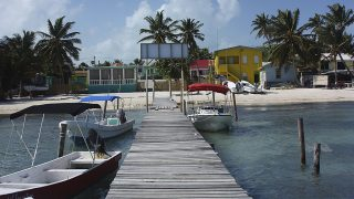 CAYE CAULKER, BELIZE - DECEMBER 27: View of the colorful shoreline from a jetty on December 27, 2008 in Caye Caulker, Belize. The laid back island of Caye Caulker, in close proximity to the world's second largest barrier reef, is a popular travel destination for both European and American tourists.  (Photo by Nina Raingold/Getty Images)