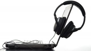 sideview of a laptop computer and hifi headphones