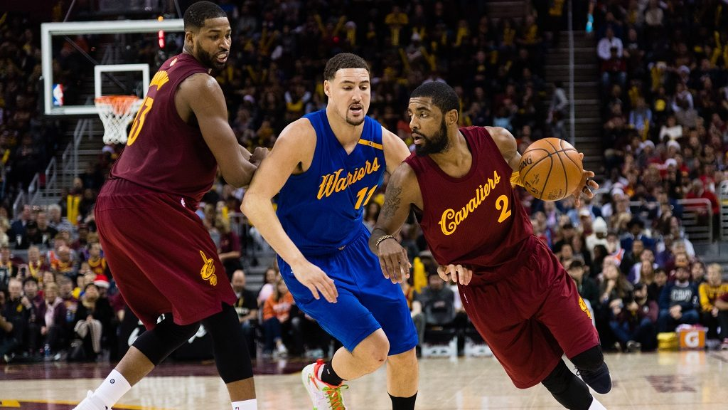 CLEVELAND, OH - DECEMBER 25: Tristan Thompson #13 sets a pick as Kyrie Irving #2 of the Cleveland Cavaliers drives around Klay Thompson #11 of the Golden State Warriors during the second half at Quicken Loans Arena on December 25, 2016 in Cleveland, Ohio. The Cavaliers defeated the Warriors 109-108. NOTE TO USER: User expressly acknowledges and agrees that, by downloading and/or using this photograph, user is consenting to the terms and conditions of the Getty Images License Agreement. Mandatory copyright notice.   Jason Miller/Getty Images/AFP