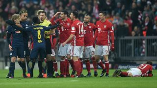 Several Bayern Munich players and Leipzig players discuss with the referee Felix Swayer after an attack of Leipzig's Swedish midfielder Emil Forsberg (L) against Bayern Munich's defender Philipp Lahm (R) during the German first division Bundesliga football match FC Bayern Munich vs RB Leipzig in Munich, Germany, on December 21, 2016. / AFP PHOTO / Christof STACHE / RESTRICTIONS: DURING MATCH TIME: DFL RULES TO LIMIT THE ONLINE USAGE TO 15 PICTURES PER MATCH AND FORBID IMAGE SEQUENCES TO SIMULATE VIDEO. == RESTRICTED TO EDITORIAL USE == FOR FURTHER QUERIES PLEASE CONTACT DFL DIRECTLY AT + 49 69 650050