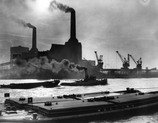 12th February 1937: Smoke belches from the famous chimneys of London's Battersea Power Station. (Photo by Fox Photos/Getty Images)