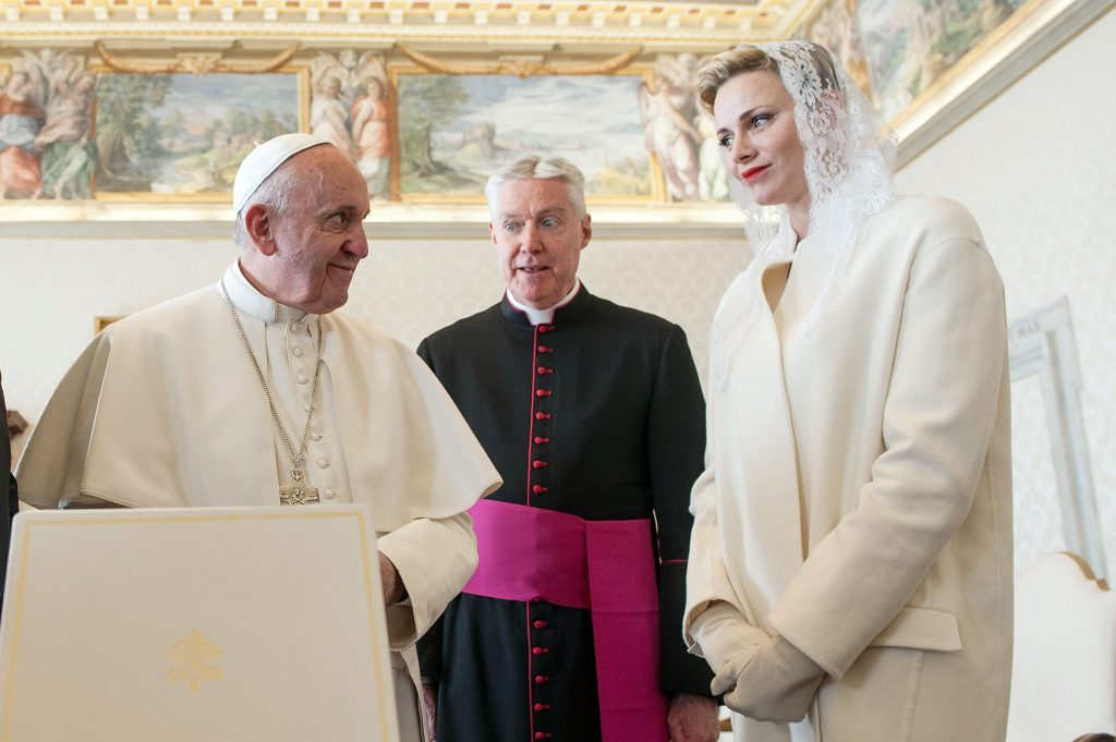 VATICAN CITY, VATICAN - JANUARY 18: Pope Francis exchanges gifts with Princess Charlene of Monaco at the Apostolic Palace on January 18, 2016 in Vatican City, Vatican. (Photo by Vatican Pool/Getty Images)