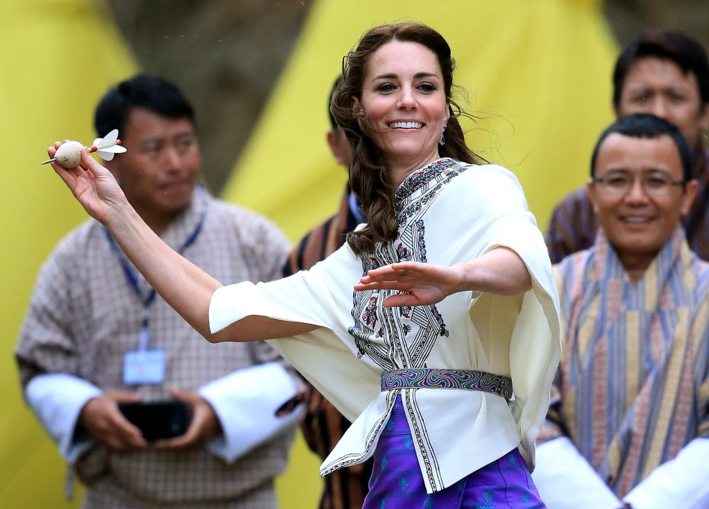 THIMPHU, BHUTAN - APRIL 14: Catherine, Duchess of Cambridge throws a dart during a Bhutanese sporting demonstration on the first day of a two day visit to Bhutan on the 14th April 2016 in Paro, Bhutan. The Royal couple are visiting Bhutan as part of a week long visit to India and Bhutan that has taken in cities such as Mumbai, Delhi, Kaziranga, Bhutan and Agra. (Photo by Chris Jackson/Getty Images)