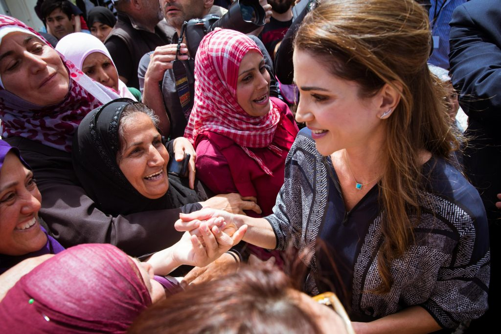 MYTILENE, GREECE - APRIl 25: In this handout image supplied by the Office of Her Majesty Queen Rania Al Abdullah, Royal Hashemite Court, Queen Rania of Jordan meets Syrian refuges at the Karatepe municipality camp for refugees on the outskirts of Mytilene, on April 25, 2016 in Lesbos, Greece. Queen Rania has travelled to Lesbos at the invitation of the International Rescue Committee (IRC), her visit coming just over a week after that of Pope Francis. (Photo by Royal Hashemite Court via Getty Images)