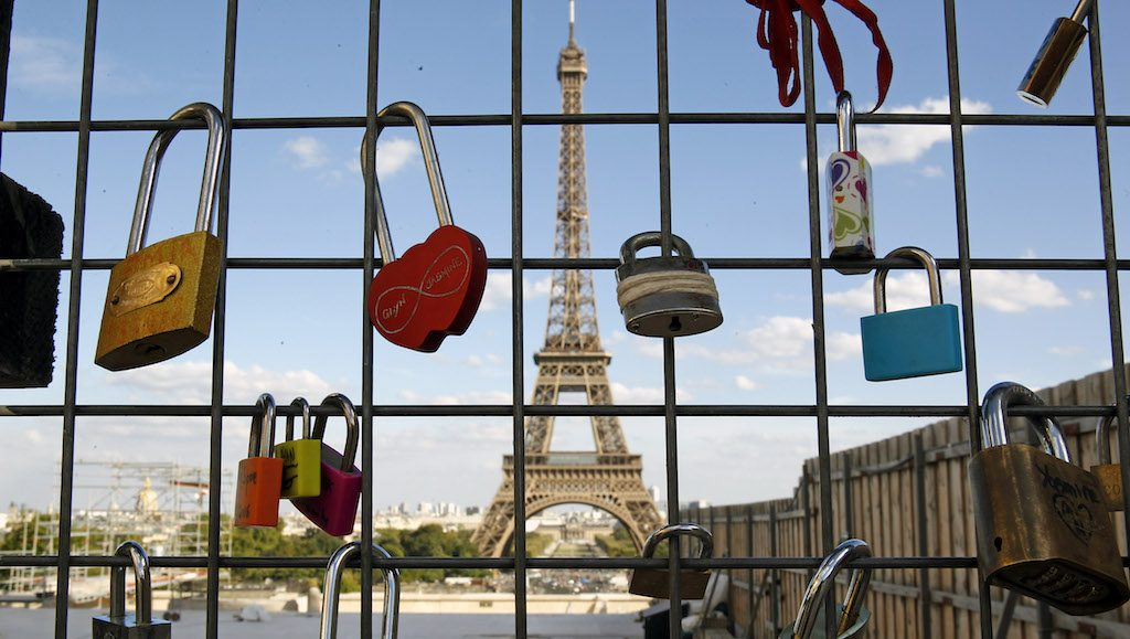 PARIS, FRANCE - SEPTEMBER 01:  Love padlocks are seen in front of the Eiffel tower on September 1, 2016 in Paris, France. The accumulation of 'love locks', is a popular phenomenon in many European cities, where couples attach a lock to symbolize their love.  (Photo by Chesnot/Getty Images)