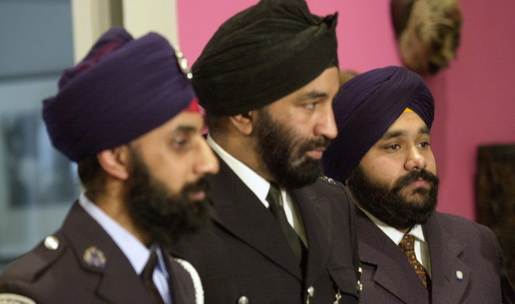 UNITED STATES - MARCH 04:  From left, Pardeep Singh Nagra, of the Ontario police; Kashmira Singh Mann, chairman of the Metropolitan Police Sikh Association in London, and Amric Singh Rathour, a former New York cadet traffic agent, attend a service at the Interfaith Center of New York. Rathour, a Sikh, was fired by the Police Department for refusing to trim his beard, remove his turban and wear a department-issued hat. He has filed a federal discrimination suit against the NYPD.  (Photo by David Handschuh/NY Daily News Archive via Getty Images)