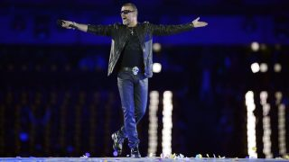 (FILES) This file photo taken on August 12, 2012 shows British singer George Michael performing during the closing ceremony of the 2012 London Olympic Games at the Olympic stadium in London. British pop singer George Michael, who rose to fame with the band Wham! and sold more than 100 million albums in his career, has died aged 53, his publicist said on December 25, 2016. / AFP PHOTO / LEON NEAL