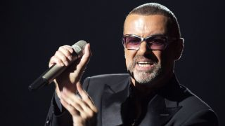 (FILES) This file photo taken on September 9, 2012 shows British singer George Michael performing on stage during a charity gala for the benefit of Sidaction, at the Opera Garnier in Paris. George Michael died aged 53, according to his publicist on December 25, 2016.  / AFP PHOTO / MIGUEL MEDINA
