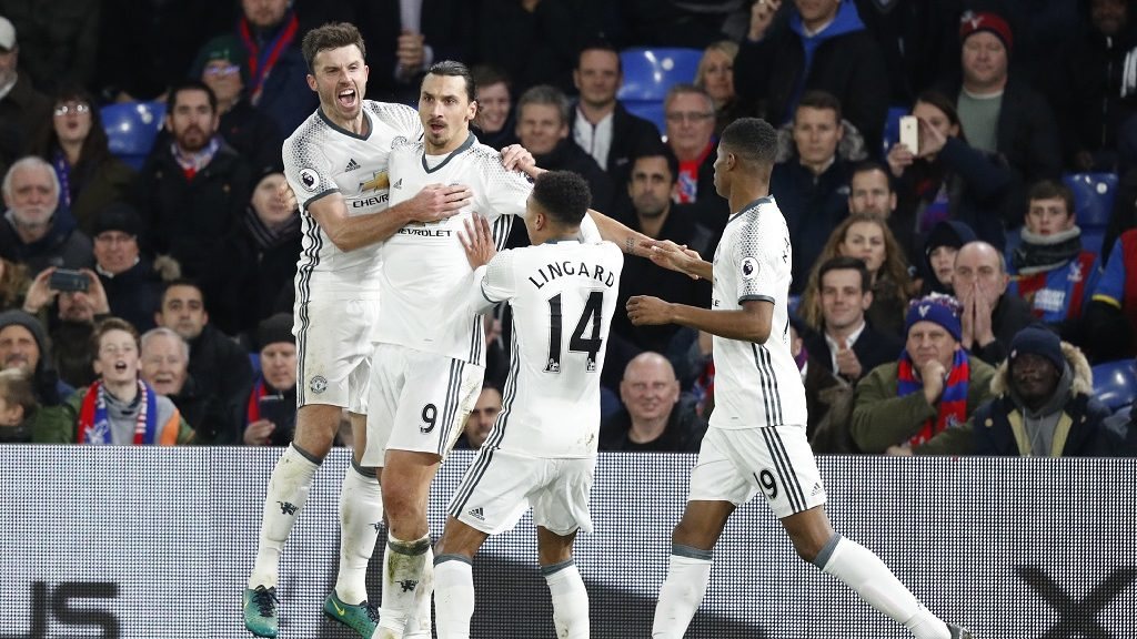 Manchester United's Swedish striker Zlatan Ibrahimovic (2L) celebrates scoring their second goal with Manchester United's English midfielder Michael Carrick (L) and Manchester United's English midfielder Jesse Lingard (2R) during the English Premier League football match between Crystal Palace and Manchester United at Selhurst Park in south London on December 14, 2016. / AFP PHOTO / Adrian DENNIS / RESTRICTED TO EDITORIAL USE. No use with unauthorized audio, video, data, fixture lists, club/league logos or 'live' services. Online in-match use limited to 75 images, no video emulation. No use in betting, games or single club/league/player publications.  /