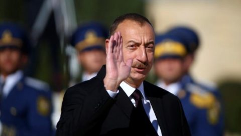 Azerbaijan's President Ilham Aliyev waves during a meeting with Pope Francis at the Presidential Palace in Ganjlik, Azerbaijan October 2, 2016. REUTERS/Alessandro Bianchi