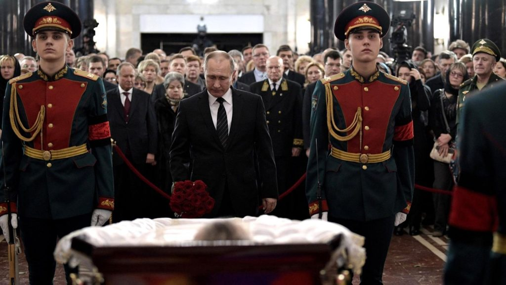 MOSCOW, RUSSIA - DECEMBER 22: Russian President Vladimir Putin, stands behind the coffin during funeral service for Russia's ambassador to Turkey Andrey ?Karlov, in Christ the Savior Cathedral in Moscow, Russia, on December 22, 2016. Karlov was delivering a speech at the opening ceremony of a photo exhibit when an armed assailant 22-year-old riot police officer Mevlut Mert Altintas opened fire on him. Assailant has been killed by the Turkish police during a fire exchange at the crime scene. Kremlin Press Office / Anadolu Agency