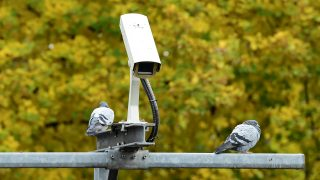 A surveillance camera is pictured in Berlin on October 26, 2016.    / AFP PHOTO / TOBIAS SCHWARZ