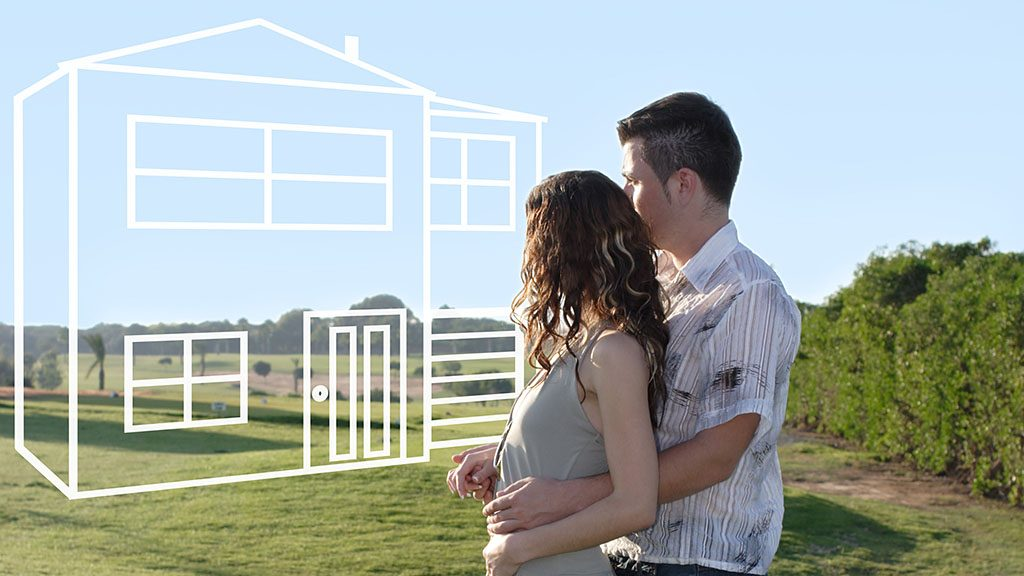 Young couple dreaming about a house in beautiful district
