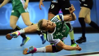 Hungarian Gyor Audi ETO's Heidi Loke scores a goal during the EHF Women's Champions League Final Four final match between CSM Bucuresti and Gyori Audi ETO KC at the Papp Laszlo Arena in Budapest on May 8, 2016.  / AFP PHOTO / ATTILA KISBENEDEK