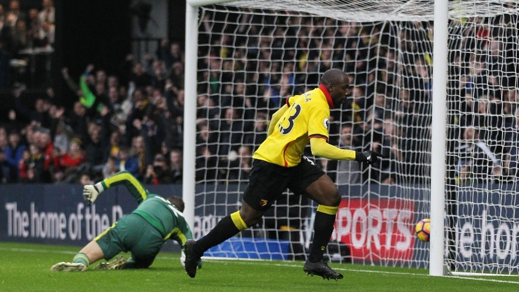 Watford's Italian striker Stefano Okaka (R) wheels away after scoring during the English Premier League football match between Watford and Everton at Vicarage Road Stadium in Watford, north of London on December 10, 2016. / AFP PHOTO / Ian KINGTON / RESTRICTED TO EDITORIAL USE. No use with unauthorized audio, video, data, fixture lists, club/league logos or 'live' services. Online in-match use limited to 75 images, no video emulation. No use in betting, games or single club/league/player publications.  /