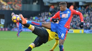 Watford's Uruguayan defender Miguel Britos (L) vies with Crystal Palace's Ivorian-born English striker Wilfried Zaha during the English Premier League football match between Watford and Crystal Palace at Vicarage Road Stadium in Watford, north of London on December 26, 2016. The game finished 1-1. / AFP PHOTO / OLLY GREENWOOD / RESTRICTED TO EDITORIAL USE. No use with unauthorized audio, video, data, fixture lists, club/league logos or 'live' services. Online in-match use limited to 75 images, no video emulation. No use in betting, games or single club/league/player publications.  /