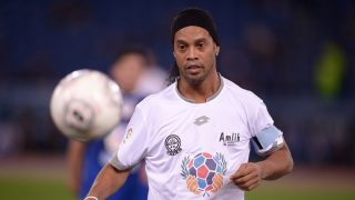 Brazil's Ronaldinho controls the ball during the 'Match of Peace - United for Peace' charity football match promoted by the Schools for Encounter foundation at the Olympic stadium in Rome on October 12, 2016.  / AFP PHOTO / FILIPPO MONTEFORTE