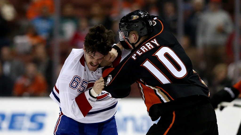 ANAHEIM, CA - NOVEMBER 29: Andrew Shaw #65 of the Montreal Canadiens fights with Corey Perry #10 of the Anaheim Ducks during the first period of a game at Honda Center on November 29, 2016 in Anaheim, California.   Sean M. Haffey/Getty Images/AFP