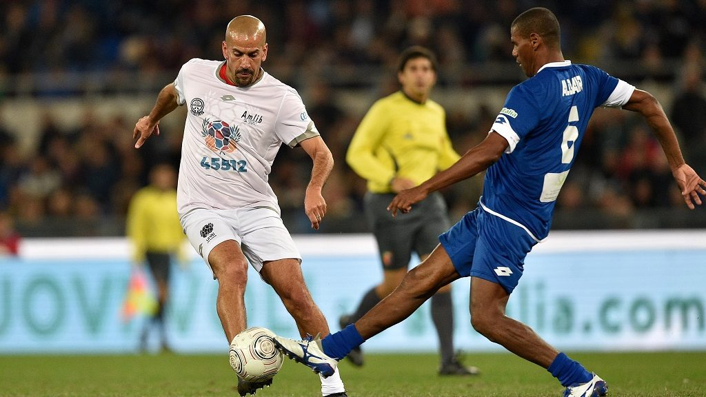 ROME, ITALY -  OCTOBER 12 :  Aldair Nascimento Santos (R) is in action against Sebastian Veron (L) during the 'Match of Peace - United for Peace', charity soccer match promoted by the Schools for Encounter foundation, an organization boosted by Pope Francis, at Olimpico stadium in Rome, Italy on October 12, 2016. Claudio Pasquazi / Anadolu Agency